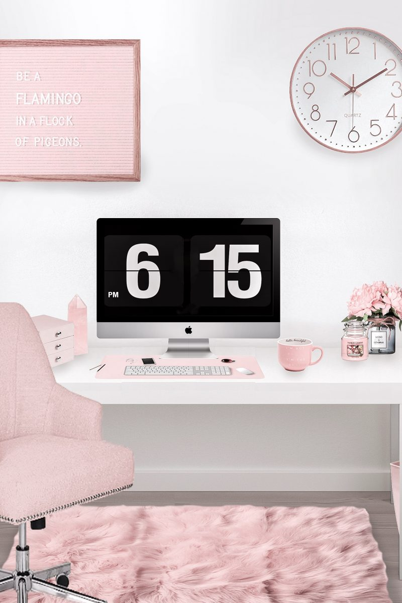 Cute feminine desk with lots of pink office decor pieces